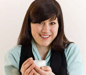 Young woman with tea cup