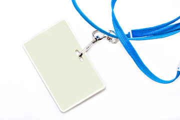 Name tag and blue lanyard on a white background.