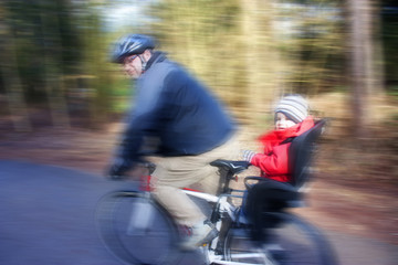 father and son on bike