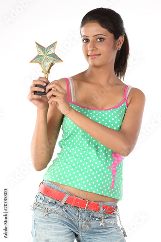 Happy teenage girl with star trophy