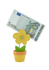 5 euro banknote in a holder in the form of flower pot