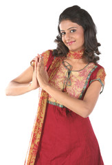 Indian teenage girl in welcoming pose
