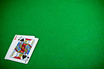 Cards over green poker table
