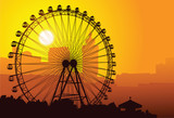 Silhouette of a ferris wheel at sunset.