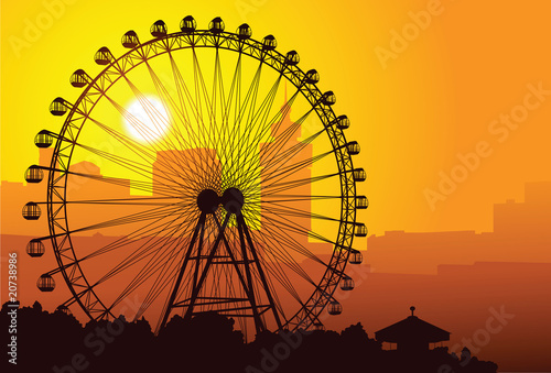 Silhouette of a ferris wheel at sunset. - 20738986