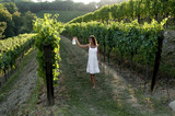 Young woman in vineyard holding lantern
