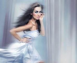 Beautiful brunette running - dynamic motion blur version
