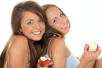 Teenage girls with apples