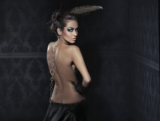 Vogue style photo of a stunning brunette beauty