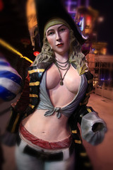 sexy woman pirate statue at night