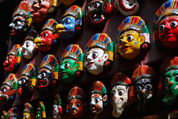 Colorful wooden masks on the wall
