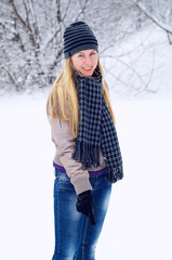 Young happy smiling blond girl outdoor in winter