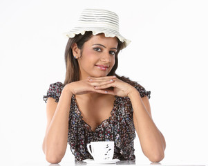 Smiling woman with cup of coffee relaxing happily