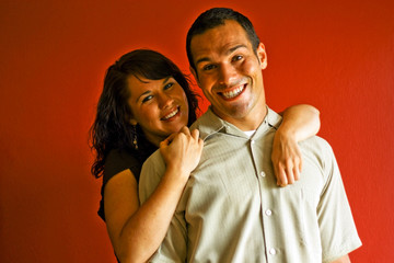 Young Attractive Couple Relationship Hugging in Love Smiling