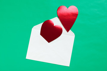 red heart in paper envelope