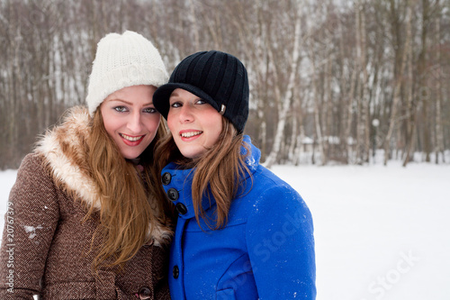 sisters posing for the camera in winter