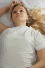 sexual girl in studio in white tunic