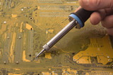 Soldering a circuit board poster