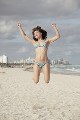 Woman jumping in mid-air