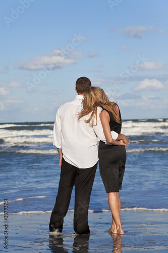 Romantic Man and Woman Couple Embracing On A Beach