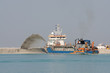 Special dredge ship pushing sand to create new land - 20796168