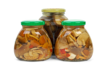 Glass jars with marinated mushrooms