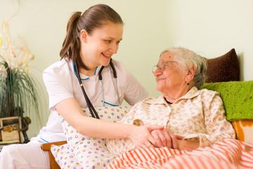 Helping a sick elderly woman