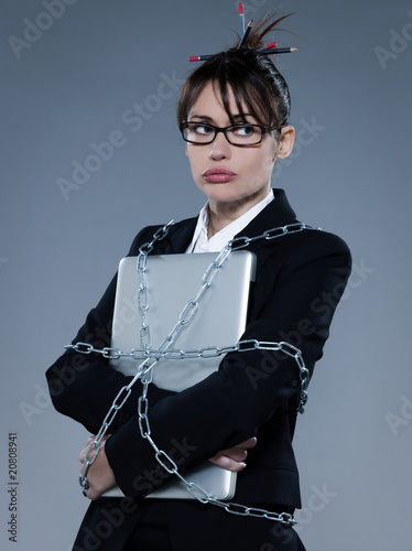 beautiful business woman chained to her laptop