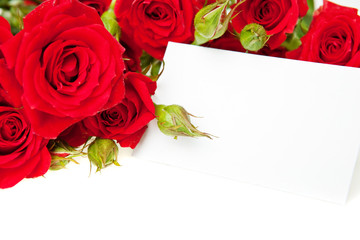 Red roses and blank invitation card