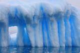 Iceberg with window in Antarctica
