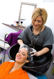 Fototapety hair stylist washing woman hair