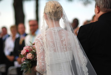a bride and her father walking down the aisle on her wedding day
