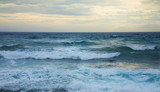 ocean waves, partially overcast yellow sky poster
