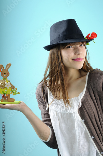 european young woman holding easter gifts