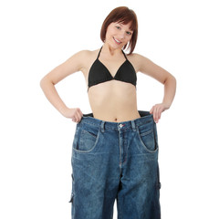 Teen woman showing how much weight she lost