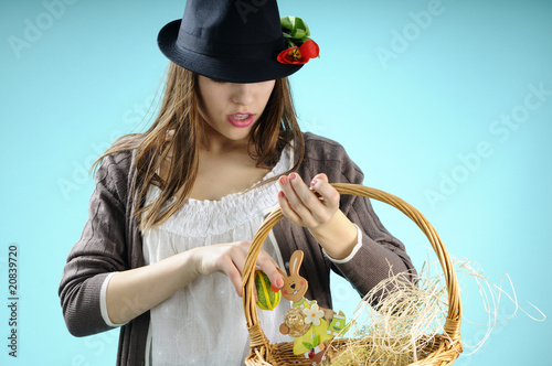 caucasian young woman choosing eggs for easter