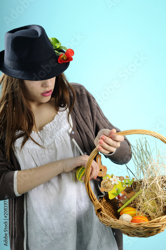 girl with red tulip choosing easter decorations