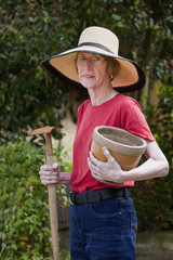 Beautiful mature woman working in garden