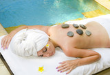The young beautiful woman to Spa procedures in pool poster
