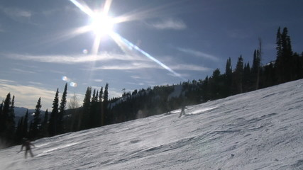 Skiers on a slope at a ski resort