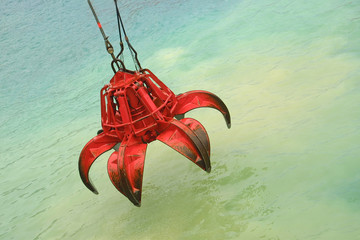 Bucket of crane above the water