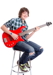 Youth with red guitar sitting