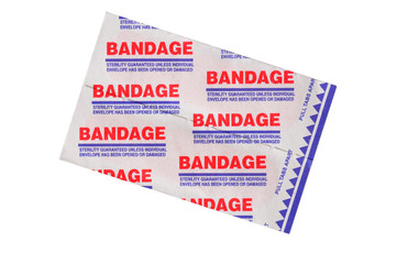Adhesive first-aid bandages in packaging on white