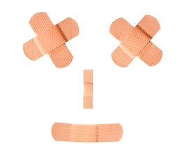 First-aid bandages arranged to resemble a face
