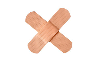 "Adhesive bandages crossed in an ""X,"" isolated"