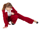 Woman in business suit kicks
