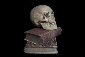 Skull and old medical books