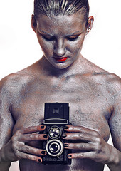 Naked photographer with 6x6 mm film camera