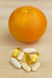 Orange and Nutrition Supplement Tablets or Medicine poster