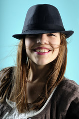 young woman smiling with black hat